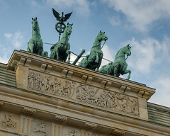 Galloping over the vignettes (Adaptabilly) Tags: berlin travel symbol sky art brandenburg basrelief people vignette architecture sculpture germany europe horse clouds lumixgx7