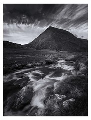 Pen Yr Ole Wen (Ollie Pocock) Tags: northwales unitedkingdom uk wales penyrolewen mood moody drama clouds grass rocks falls river nationalpark hills mountain mountains monochrome mono blackandwhite snowdonia