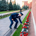 At Red Square in Moscow, Expedition 57 crewmember Nick Hague of NASA lays flowers at the Kremlin Wall where Russian space icons are interred as part of traditional ceremonies Sept. 17. Hague and Alexey Ovchinin of Roscosmos will launch Oct. 11 from the Ba