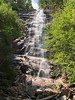 Feeling small at Arethusa Falls ! (skreechowl2003) Tags: river boulders rocks yellow wet spray waterfalls water branches sticks green blue sky woodland forests woods falls trees people