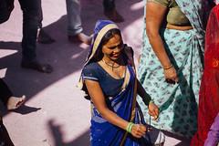 Woman Walking on Gulal-Covered Street (AdamCohn) Tags: abeer adamcohn hindu india vrindavan gulal holi pilgrim pilgrimage pilgrims अबीर गुलाल होली