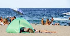 Sunbathing... (Pedro1742) Tags: beach people sea blue tent green