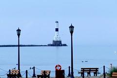 Beach Life Northeastern Ohio Style (Eat With Your Eyez) Tags: water great lake erie ohio shoreline beach summer haze lighthouse dock bench panasonic fz1000 seagulls canadian geese