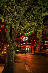 Just a peak at Victoria's Chinatown (vanessa_macdonald) Tags: vancouverisland vanisle britishcolumbia bc nightphotography nightscape night life reflections glow warm lights streetscape cityscape city urban victoria victoriabc tourism travel town sidewalk