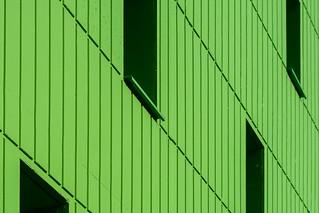 Green facade with windows