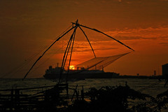 """Clouds come floating into my life, no longer to carry rain or usher storm, but to add color to my sunset sky."" - Rabindranath Tagore (Abeer!) Tags: abeer abeerbarman arabiansea waterscape landscape water waves boat beach clouds cochin dusk kerala fortkochi india kochi nature portrait sky scenery sunset sea ship shore red chinese fishing fishingnets chinesefishingnets"