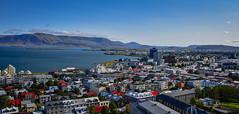 City view from Hallgrimskirkja - Reykjavík Iceland (mbell1975) Tags: reykjavík iceland is city view from hallgrimskirkja island ísland icelandic water sea atlantic ocean inlet faxa bay mountain range mountains landscape paysage aerial town