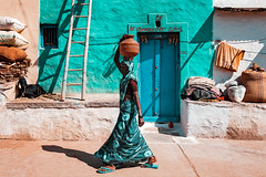 Street. Aihole, India (Marji Lang Photography) Tags: aihole india indiansubcontinent indianvillage indianwoman karnataka outdoors traditionalclothing traditionalvillage travelphotography blue carrying carryingwater carryingwaterjar colorful colorfulbuilding colorfulwall colors composition daylight documentary door goat horizontal indian jar ladder oneperson onewoman people ruralindia saree sari southindia street streetscene streetshot tealcolor town traditionalindia traditionalhome traditionalhouse turquoise village waterjar woman