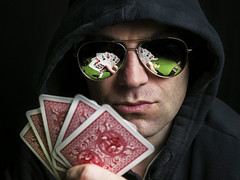 Poker Face (MomoFotografi) Tags: poker face portrait reflection glasses game fun sunglasses cards play playing hood attitude mirror