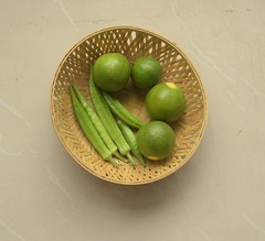 Garden Bounty (Vidya...) Tags: okhra ladiesfinger green lemons wicker basket kitchen garden last season warm light nikond5300 85mm