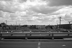 Overpass (OzGFK) Tags: ricoh35zf film analog 35mm rollei25rpx clouds urban industrial blackandwhite monochrome cloud contrast road bridge overpass