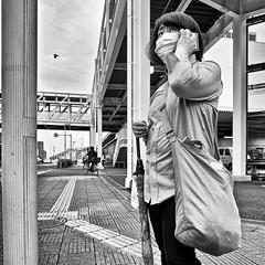 saitama, japan (michaelalvis) Tags: asia bw blackandwhite buildings candid city citylife cellphones cellphone fujifilm japan japanese japon bicycles monochrome nihon nippon peoplestreet portrait people streetphotography streetlife street saitama travel tokyo urban women woman x70