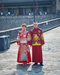 2018 Xi'an - On and Around the Old City Walls 52 (C & R Driver-Burgess) Tags: xian wall city towers ancient historical stone defense tourist west gate wedding marriage couple man woman bride husband groom wife red traditional dress robes smile glasses young pretty 西安 西门