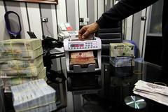 Libya imposes fee on hard currency transactions to bridge black market gap (majjed2008) Tags: hard black bridge currency fee gap imposes libya market transactionstripolilibya