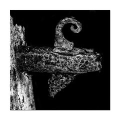 Rusty Old Catch (Mark Wasteney) Tags: blackwhite bw catch metal rust rusty squareformat photoborder fra