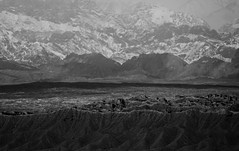 The beginning and end.. (setoboonhong) Tags: travel landscape mountains arid sand rocks shadows sunlight snow highway between kuqa aksu xinjiang china old silk road moving bus hand held sony rx10miv continuous focus monochrome bw textures