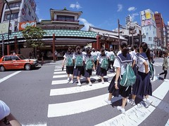 School Girls (lildragonsubaru) Tags: students schoolgirls future cute japan tokyo sensoji afternoon cross street taxi redcar crown asahi ad sign safe