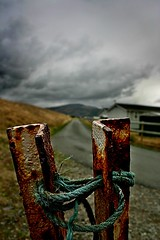 Over time beauty can be in the decay (captainmorganme) Tags: rust road perspective wales fairbourne sky dark cloud stormy decay urbandecay