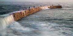Sennen Breakwater Wall (Andrew Hocking Photography) Tags: sennen cove harbour beach breakwater wall waves sea seaside water coast seascape landscape coastal longexposure motion pouring cornwall uk gb hightide