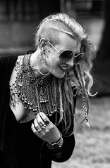 Circles and lines (MauScaMe) Tags: 70200 lady tattoo glasses rings jewellery lookingdown smile blackandwhite