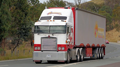 Federal Highway (1/5) (Jungle Jack Movements (ferroequinologist)) Tags: australian capital territory act nsw federal highway canberra new south wales border australia pambula kenworth phoenix trucking ks freighters scania freightliner chemicals danger arrows express bobbins hp horsepower big rig haul haulage freight cabover trucker drive transport carry delivery bulk lorry hgv wagon road nose semi trailer deliver cargo interstate articulated vehicle load freighter ship move motor engine power teamster truck tractor prime mover diesel driver cab cabin beast wheel