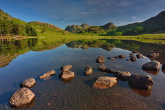 Blea Tarn greens (images@twiston) Tags: reflections bleatarn green summer langdales langdale tarn first light rocks stones boulders shore shoreline lake cumbria lakedistrict lakeland thelakes lakedistrictnationalpark nationaltrust fell fells cumbrian mountains landscape imagestwiston district national park countryside mountain still water reflection morning mirror englishlakedistrict lakes thelakedistrict reflected waterreflections sunrise dawn calm serene stupidoclock wideangle wide angle sidepike lingmoorfell pikeoblisco pikes greatlangdale littlelangdale graduated unesco worldheritagesite nisi gnd grad polarizer cpl