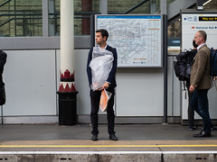Bubble Wrapped (Magic Pea) Tags: streetphotography streetphoto street candid unposed urban london photo photography magicpea farringdon clerkenwell man station waiting quirky platform bubblewrap