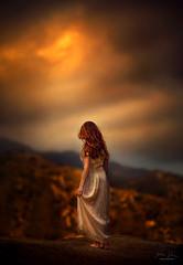 The Distance ({jessica drossin}) Tags: jessicadrossin portrait photography sunset woman dress white hair orange sky mountains distance cliff dark pretty beautiful wwwjessicadrossincom