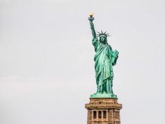 Torch bearer (Marc Rauw.) Tags: statue nyc newyork newyorkcity statueofliberty liberty green torch art sculpture olympuspenepl1 olympus pen epl1 mzuiko40150mm mzuiko 40150mm flame bartholdi eiffel america usa harbour microfourthirds m43 μ43 tourism landmark tall