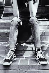 Knees Up (skye-skye) Tags: kid kids teen teens teenager teenagers film 35mm canon canonae1 develop grainy rustic urban urbanphotography child children youth young childhood monochrome mono blackandwhite vintage street streetphotography