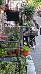 Outdoor Living, Amsterdam (Jainbow) Tags: amsterdam street road people candid legs jainbow bikes bicycles plants flowers