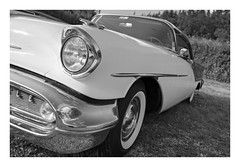 Looking towards the next Adventure (memories-in-motion) Tags: car us 88 black white mono tilt shift canon headlight mobility design drive adventure look chrome oldsmobile tse24mmf35lii