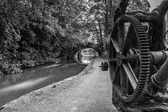 The old iron crane (andyrousephotography) Tags: worsley bridgewatercanal canal waterways crane iron operational boards drain leaks mono blackandwhite