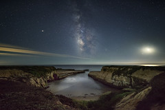 Moonlit Cove (rootswalker) Tags: cove milkyway nightphotography crescentmoon moonlight pacificocean california panorama distagont2815