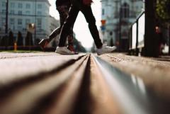 On the Rails (ewitsoe) Tags: 35mm city europe ewitsoe nikond80 street warszawa erikwitsoe poland summer urban warsaw lowdof low ground rails perspective grain couple feet motio trams polska people pedestrians sunny sunshine feel mood vibe atmosphere fortheloveofgrain grainy
