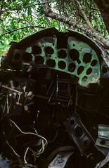 Wrecked US Vought F4U-1 Corsair Cockpit at Vilu Open-Air Museum (Serendigity) Tags: wreck aircraft corsair american solomonislands pacificocean us secondworldwar relict guadalcanal cockpit wwii rusting guadalcanalprovince sb kodachrome 35mm slide film