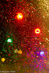Light And Water (M C Smith) Tags: light water red green orange purple abstract droplets yellow colours