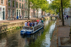 1e Year students discover Delft by tour boat (FotoCorn) Tags: netherlands bridge people delft citycenter holland sightseeing dutch students tourboat water travel tourists boat canal europe tourism studentcity zuidholland nederland