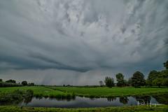 Rainclouds @ Mijdrecht (PaulHoo) Tags: rain cloud sky mijdrecht landscape green farmland water storm nikon d750 nature samyang 14mm ultrawideangle wideangle