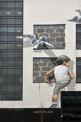 Street Art (syf22) Tags: streetart art mural painting wall cityart nuartfestival canvas picture large scenery sketch view abstract artwork depiction cityscape likeness design drawing composition colour kid boy climb gull wing bird chase