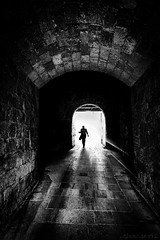 Tunnel walker B&W - DSC9750 (cleansurf2) Tags: humanelement man person perspective architecture arch tunnel black white brick bw mood monotone mirrorless minimual minimalism mygearandme people ilce7m2 urban texture sony