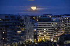 Playing hide-and-seek (Gwenael B) Tags: moon rising boulogne paris immeubles soiree nightfall atnight night astro nikond5200 tamron16300mm longexposure sky clouds hdr composite lune urban ville city moonrise fullmoon
