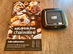 Menu and Table Pager in Chaiiwala, Walthamstow (John D McDonald) Tags: iphone iphone7plus appleiphone appleiphone7plus london geotagged food chaiiwala pager