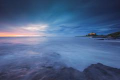 Blue Hour (ianbrodie1) Tags: blue hour bamburgh castle northumberland coast coastline history iconic hightide rocks water wave sea seascape sunrise leefilters cloud colour longexposure farne island
