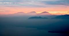 Lake Gada Sunset (Andy J Newman) Tags: italy landscape mountain om panoramic toscolanomadernu beautiful colorefex garda glow lake mist olympus panorama salo sanzeno sun sunset