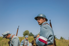 The soldier watches the situation (serhiy4) Tags: reconstruction military historical battle army soldier war world people soldiers man ukraine history infantry poland victory weapon explosion gun ww1 wwi during anniversary smoke celebrating rance helmet greatcoat look portrait rifle patrol male summer