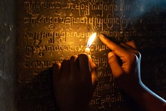 Honoring the Dead (Kathy~) Tags: myanmar candle workingwithhands hands fire low light burma pagoda friendlychallenges