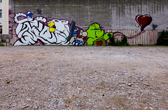 Cartoon Characters (Steve Taylor (Photography)) Tags: obelix carebear smurf balloon tiger tail animal graffiti mural streetart tag fence green red white yellow blue black brown cartoon carpark fun cool newzealand nz southisland canterbury christchurch cbd city wongiwilson emma