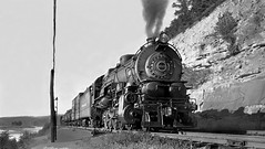 Pennsylvania Railroad I class Decapod (aka Hippo) 2-10-0 steam locomotive # 4525, is seen while leading a manifest freight train is seen on main line, ca late 1930's (alcomike43) Tags: pennysylvaniarailroad prr railroads trains freighttrains manifestfreighttrains rails ties rightofway mainline roadbed ballast conventionaljointedsectionrail tieplates anglebars spikes tracks freightcars boxcar tankcar river countyrside scenic engines locomotives steamengine steamlocomotive iclass 2100 hippo 4525 photo photograph negative old historic vintage classic bw blackandwhite