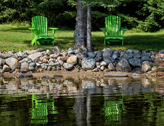 'Please be seated ... ' No. 2 (Canadapt) Tags: chairs reflection tree shoreline muskoka green keefer canadapt